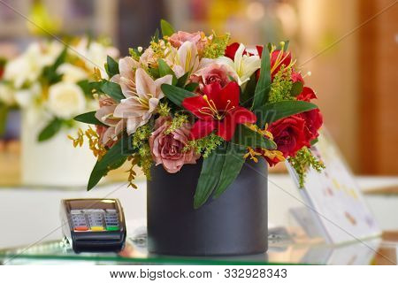 Flower Arrangement In The Interior Of The Store. Beautiful Decoration Of The Store With Flowers. Flo