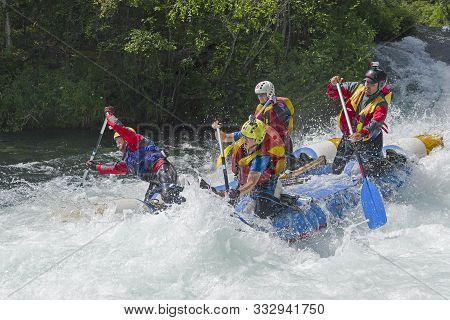 Buryatia, Russia - August 1, 2019: Sports Catamaran On The Rapids. The