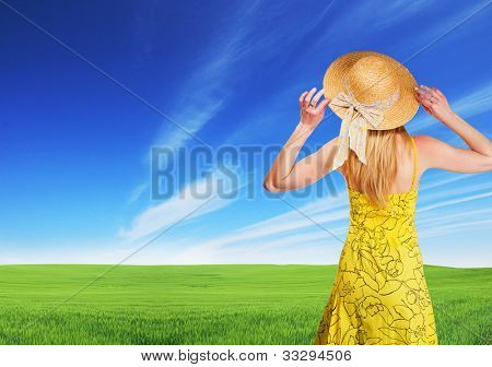 Blond woman watching green field