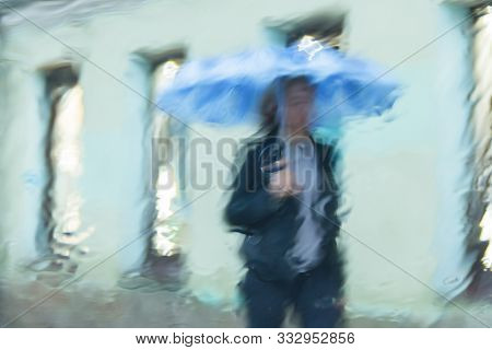 Blurred Motion Big City People Walk On Road In Rainy Day