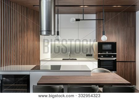 Modern Kitchen In New And Contemporary Apartment With Wooden Style Element And Built In Appliance
