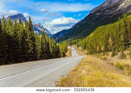 Lush autumn in the Canadian Rockies. Kananaskis highway in Rocky Mountain. The mountain valley of Peter Lougheed Park. The concept of active, ecological and photo tourism