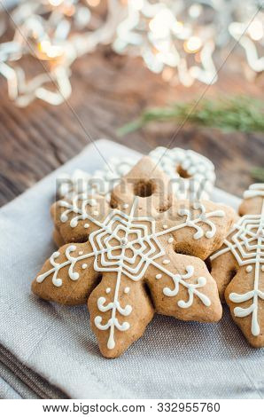 Christmas Homemade Gingerbread Cookies In Form Of Snowflake On Old Wooden Table. Xmas Moody Style Ba