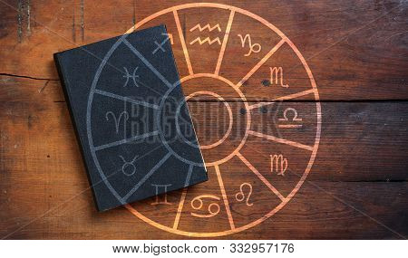 Zodiac Signs Set Over A Black Book, Wood Background.