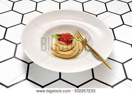 Close Up Of White Plate With Spaghetti On Modern Background