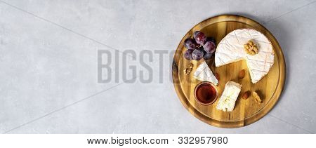 Top View Of Cheese On Wooden Board With Honey