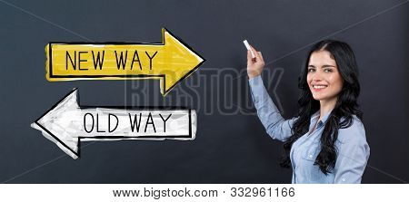 Old Way Or New Way With Young Woman Writing On A Blackboard