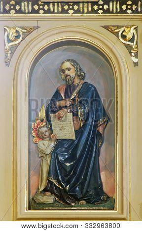 IVANIC GRAD, CROATIA - SEPTEMBER 25, 2011: Saint Matthew the Evangelist, pulpit in the church of the Saint Peter in Ivanic Grad, Croatia