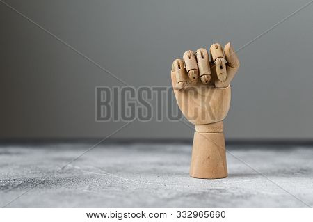 The Wooden Hand Is Clenched Into A Fist. The Concept Of Communication.
