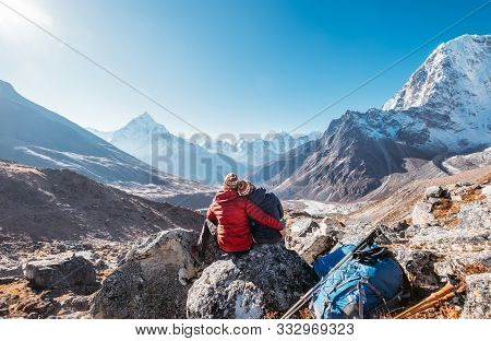 Embracing Couple On The Everest Base Camp Trekking Route Near Dughla 4620m. Backpackers Left Backpac