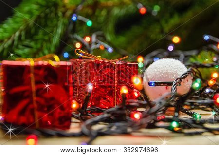 Beautiful Christmas And New Year Background With White Christmas Balls, Small Red Gift Boxes, Christ