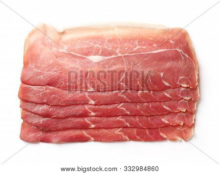 Prosciutto Slices Isolated On A White Background, Top View