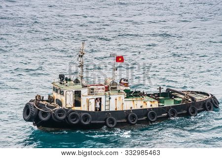 Nha Trang, Vietnam - March 11, 2019: Evening, Closeup Of Tugboat With Skipper Visible And National F