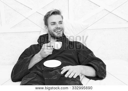 A Fresh Drink For Breakfast. Happy Man Drinking Coffee For Breakfast. Handsome Guy Enjoying His Brea