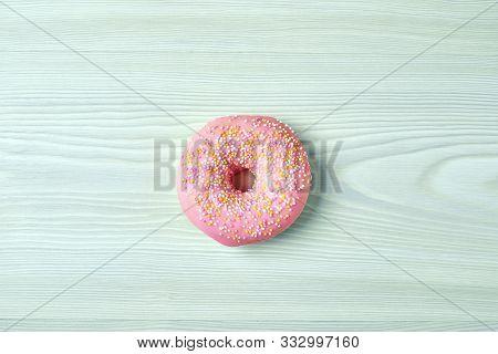Freshly Baked Donut On Blue Wooden Desk, Top View
