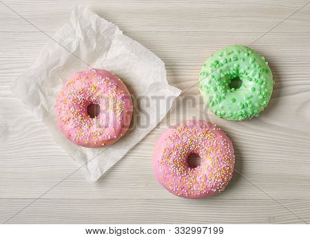Freshly Baked Donuts On Grey Wooden Desk, Top View