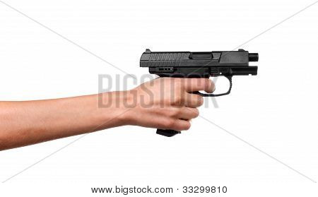 Woman hand holdin 9mm handgun