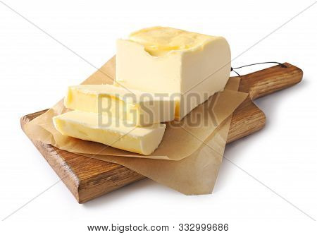 Pieces Of Butter On Wooden Cutting Board Isolated On White Background