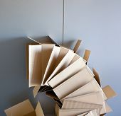 carton open boxes stacked on curved circle shape on gray wall poster
