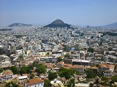Arial view of Mount Lycabettus and the surrounding populated city. poster