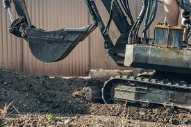 Bucket Of A Small Crawler Excavator. Excavator Mechanical Part For Digging. Machines And Mechanisms