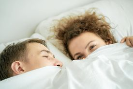 Close Up Portrait Face Of Love Couple Lying On Bed Together