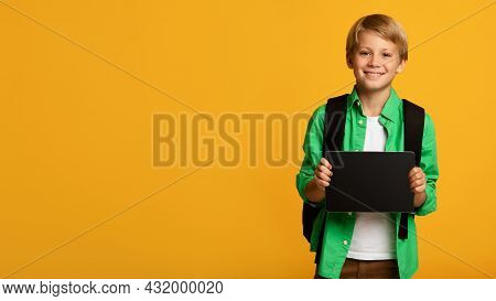 Happy Teenager Blond Boy, Caucasian Pupil Show Tablet With Empty Screen