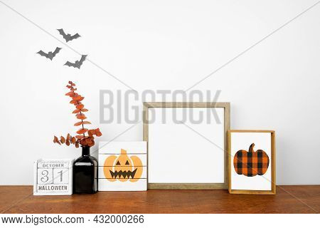 Halloween Mock Up. Shabby Chic Wood Signs, Calendar And Orange Branch Decor On A Wood Shelf Against