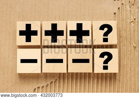 Concept Of Opposites, Plus And Minus, Flat Lay. Wooden Figures Plus And Minus On The Background Craf