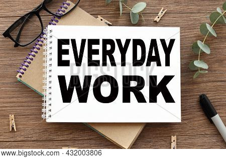 Everyday Work. Text On White Paper On Wood Table Background