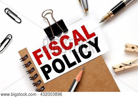 Fiscal Policy, The Inscription On The Business Card Is Attached To The Notebook.