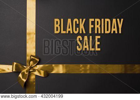 Black Friday Concept. Black Friday Sale On Dark Background. Colored Ribbons On Black