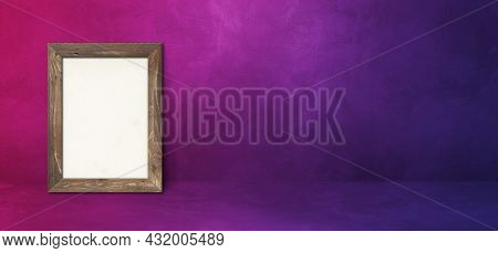 Wooden Picture Frame Leaning On A Purple Wall. Blank Mockup Template. Horizontal Banner
