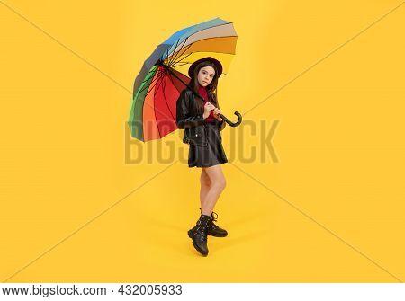 Kid In Hat With Rainbow Umbrella. Autumn Season. Rainy Weather Forecast.