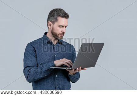 Start Quickly. Bearded Man Work On Laptop. E-commerce Startup. E-business. Startup Company