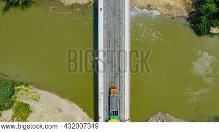 Above Top View, Overhead, On Transportation Truck Delivery Hot Tarmac Over Unfinished Bridge Covered