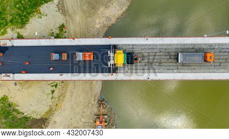 Above Top View, Overhead, On Transportation With Truck Delivery Of Hot Tarmac Over Unfinished Bridge