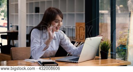 Cheerful Young Asian Woman Using Laptop Computer At Home. Student Female In Living Room. Online Lear