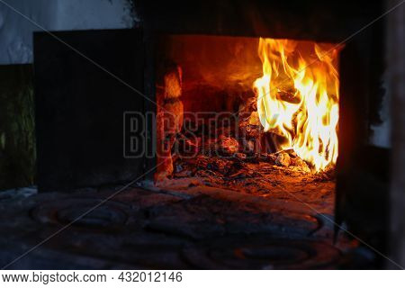 Defocus Fire Flame Background. Firewood Burning In Old Stove Or Oven. Dark And Black. Orange Flame.