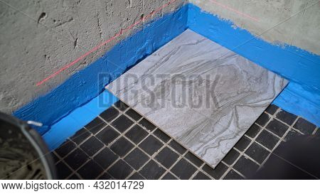 Laying The Floor With Ceramic Tiles. Floor Repair. Ceramic Tiles. The Tiler Is Laying Ceramic Tiles
