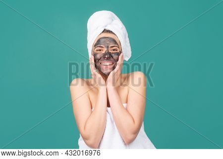 Beautiful Woman With A Clay Or A Mud Mask On Face, Clay Mask Spa. Beautiful Woman With Cosmetic Mud
