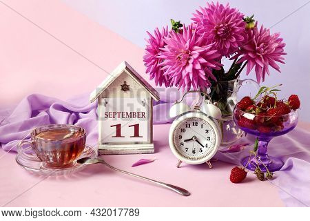 Calendar For September 11 : The Name Of The Month In English, Cubes With The Number 11, A Bouquet Of