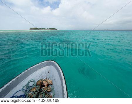 Shallow Atoll Turquoise Waves Around Mnemba Island In The Indian Ocean Near The Zanzibar Island, Tan
