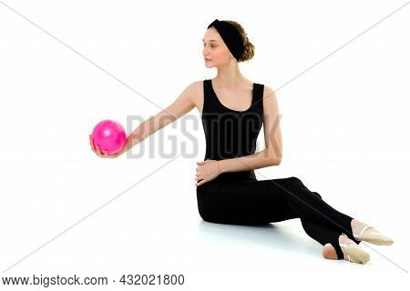 Pretty Girl Doing Gymnastics With Training Pink Ball. Attractive Sports Girl Wearing Black Leotard D