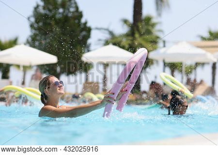 Tourists Are Engaged In Water Aerobics In The Pool At Resort Closeup