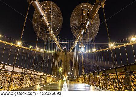 Brooklyn Bridge Pedestrian Walkway At Night In New York City, Ny, Usa