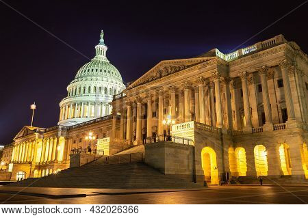 The United States Capitol Building At Sunset At Night In Washington Dc, Usa
