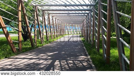 Cycle Lane-bike Path With A Wooden Fence, In Summer
