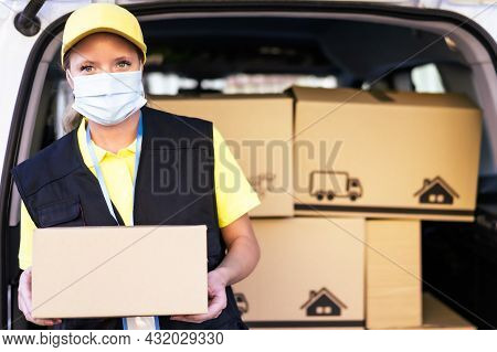 Health Protection, Safety And Pandemic Concept Delivery Woman In Face Protective Medical Mask Holdin