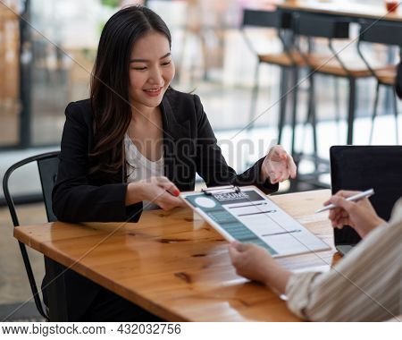Job Interview In Office, Focus On Resume Writing Tips, Employer Reviewing Good Cv Of Prepared Skille